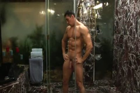 Muscle dude Cums In Shower